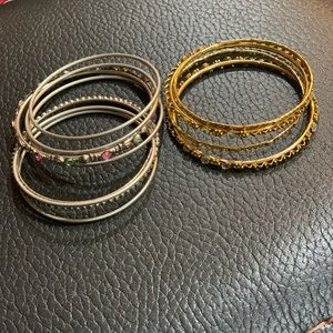 Two sets of bangles: silver and gold
